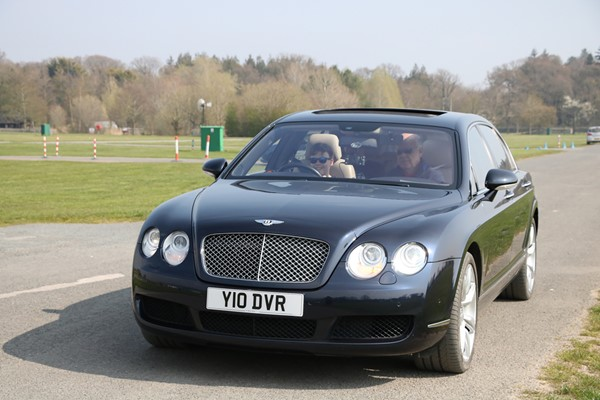 Young Driver Driving Lesson In A Bentley Flying Spur